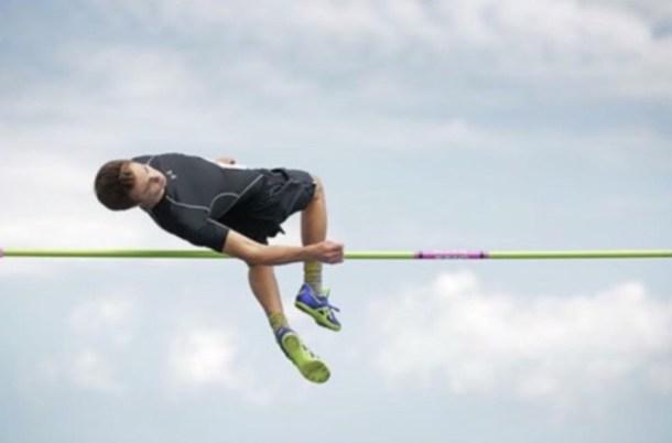 Eythan jumping over the high jump bar.