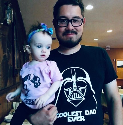 Patrick and his daughter wearing Star Wars t shirts.