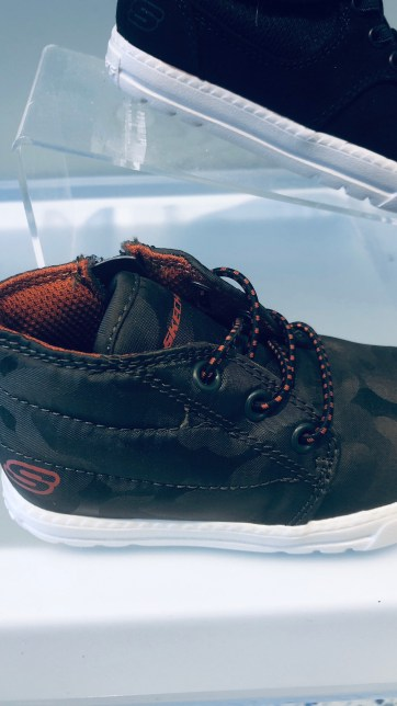 A picture of camouflage shoes for a baby boy.
