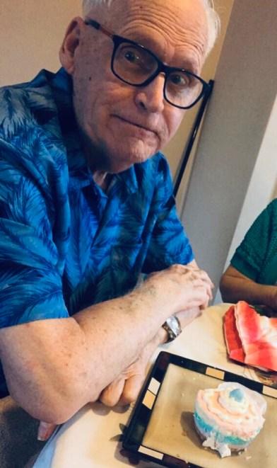 Melody's dad enjoying a cupcake.