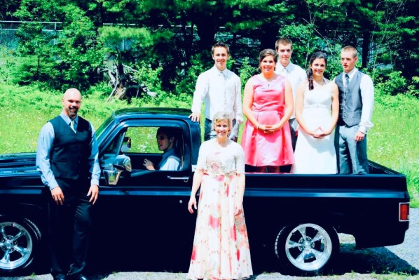Our whole family at Charity and Dan's wedding. We posed in front of a truck. Kyle is in the driver's seat.