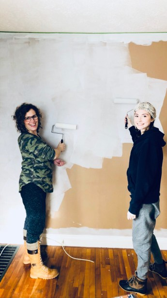 Jazmin and Cindy painting the living room in the new house