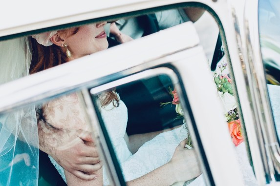 Bride and Groom in white car.