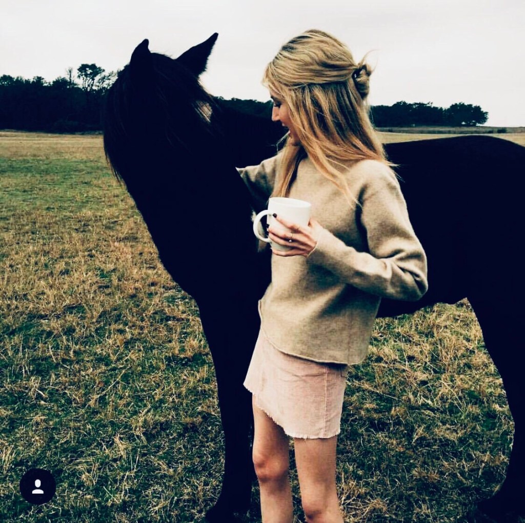 Gayle petting a horse