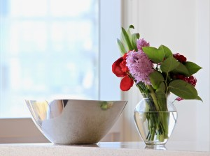 vase of flowers and shimmering decorative bowl