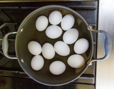 eggs in a pot of water on the stove