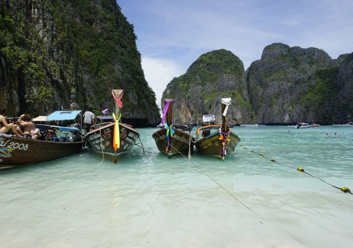 long-tail boats at Maya Bay in Phi Phi Island, Thailand