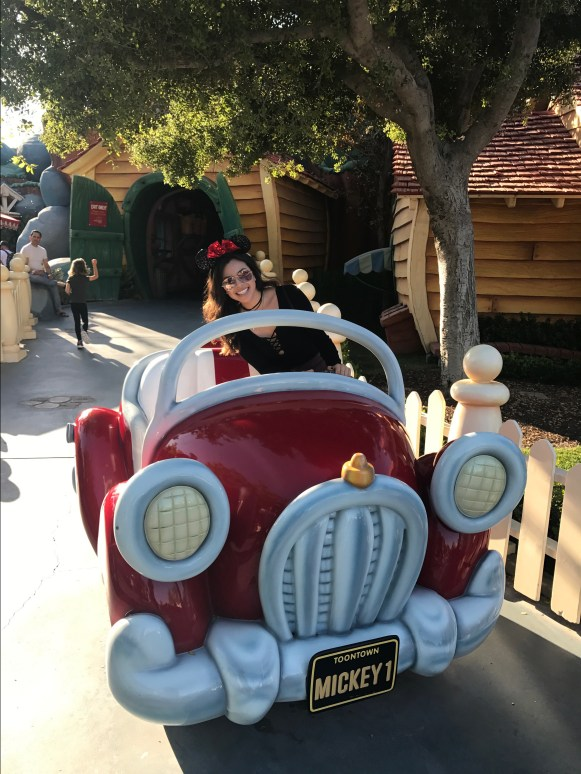girl on a Mickey Mouse car at Disneyland