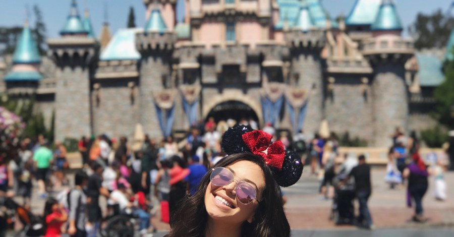 girl at Disneyland with Mickey Mouse ears