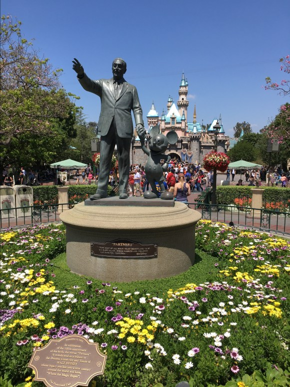 Walt Disney statue with Mickey Mouse at Disneyland