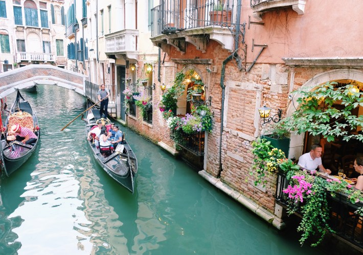 gondola ride at venice canals Italy