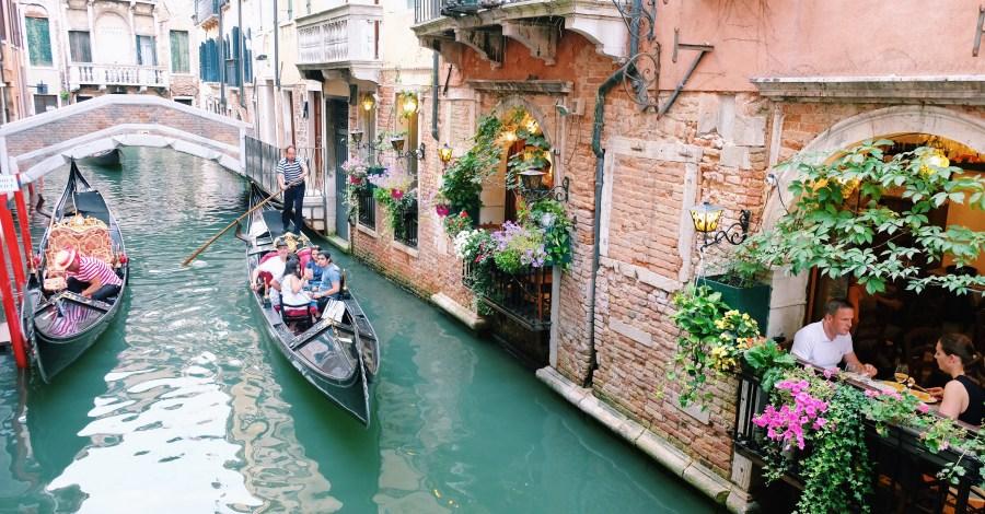gondola ride at venice canals Italy