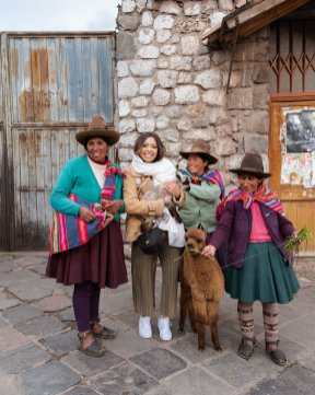 alpacas and traditional women in Peru