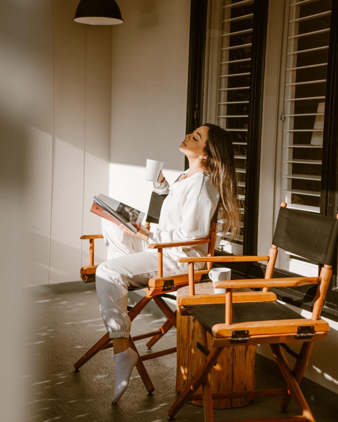 girl photography, creative photography, girl enjoying a book in the sun