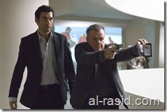 """Clive Owen as """"Louis Salinger"""" and Jack McGee as """"Detective Bernie Ward"""" in Columbia Pictures' thriller THE INTERNATIONAL."""