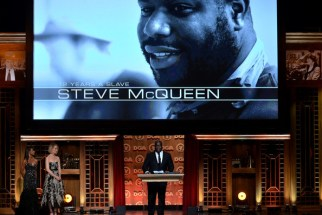 McQueen accepts the Feature Film Nomination Plaque for 12 Years a Slave onstage at the 66th Annual Directors Guild Of America Awards.