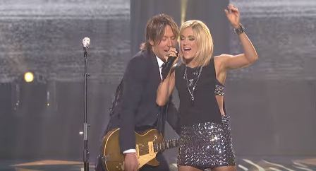 Judge Keith Urban with Season 4 champ Carrie Underwood