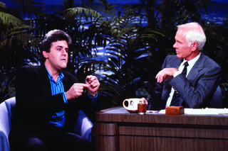 THE TONIGHT SHOW STARRING JOHNNY CARSON -- Air Date 06/22/1988 -- Pictured: (l-r) Comedian Jay Leno during an interview with host Johnny Carson on June 22, 1988 -- Photo by: Chris Haston/NBCU Photo Bank