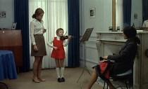 Christine giving a violin lesson