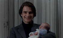 Antoine poses for a photo with the baby