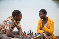 David Oyelowo is Robert Katende and Madina Nalwanga is Phiona Mutesi in Disney's QUEEN OF KATWE, the vibrant true story of a young girl from the streets of rural Uganda whose world rapidly changes when she is introduced to the game of chess.