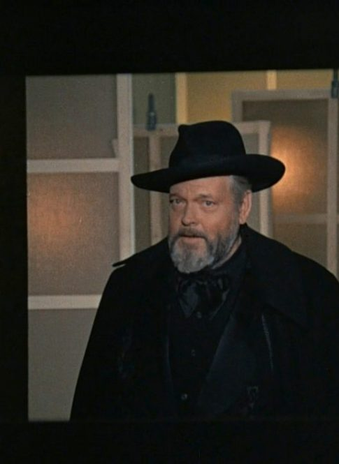 Orson Welles in hat and cape