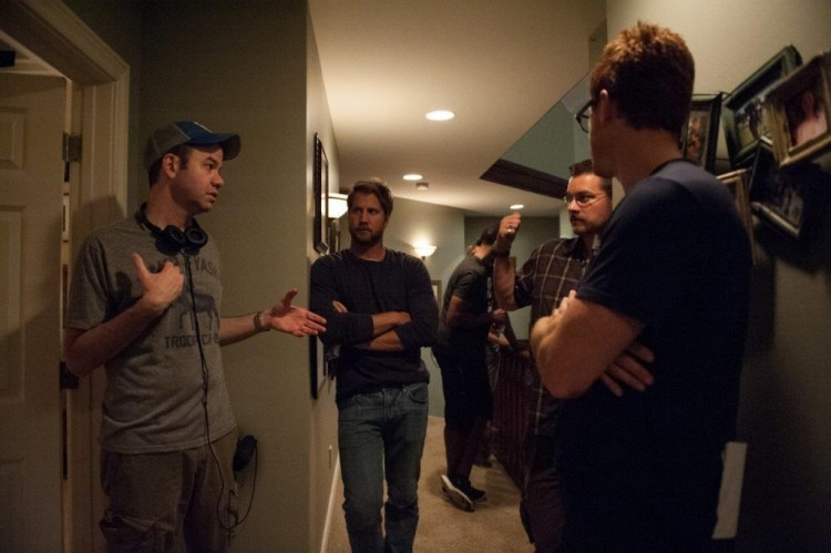 Left to right: Director Gregory Plotkin, Chris J. Murray, and Director of Photography John W. Rutland on the set of Paranormal Activity: The Ghost Dimension from Paramount Pictures.Photo credit: Suzanne Tenner © 2015 Paramount Pictures. All Rights Reserved.
