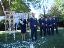 mike waiting for his bride with reverend ingrid and groomsmen; note the flower petals :)
