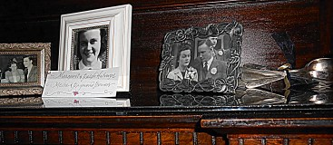 one of the mantles @ the venue; decorated with family photos and old silverware tied with ribbon