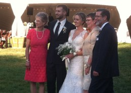 mom of groom, parents of bride with the couple photo courtesy of marcia hester