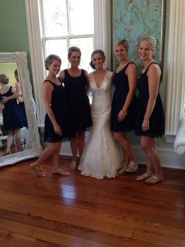bridesmaids' dresses: navy blue from jcrew, eyelet fabric; gold sandals of their choice