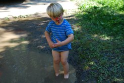 In the middle of mud play, Silas stops to do some tai chi.