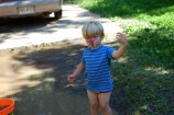 """In the midst of the mud play, Silas stops to do some """"tai chi."""""""