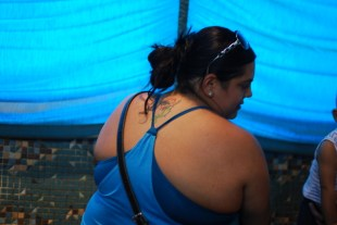 It's hard to see here, bu this lady has a mermaid tattoo on the back of her neck.