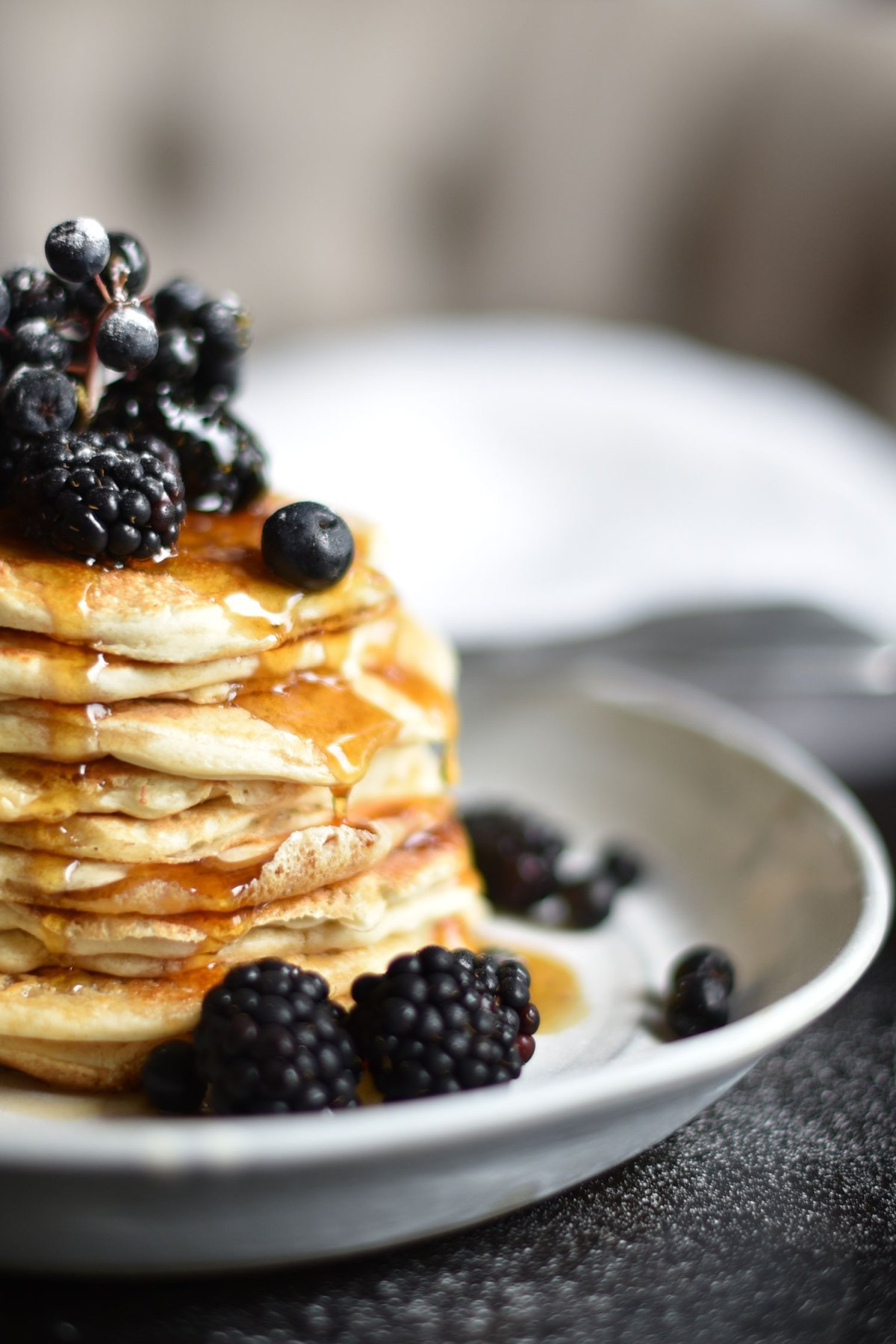 Pancakes with blackberries, blueberries and maple syrup for a nutritious breakfast