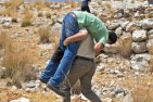 18 July - Palestinian shot by Jewish soldiers carried to medics ISM