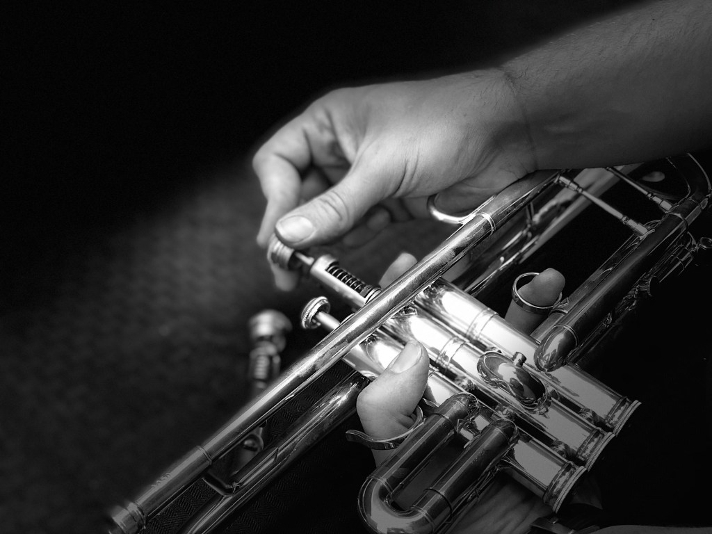 Close-up demonstration of how to remove a trumpet valve for maintenance