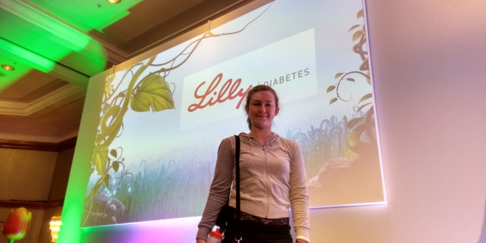 Amy on stage at the Lilly National Paediatric Team Meeting