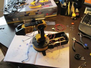 Here, the OWI Robotic Arm is being assembled.