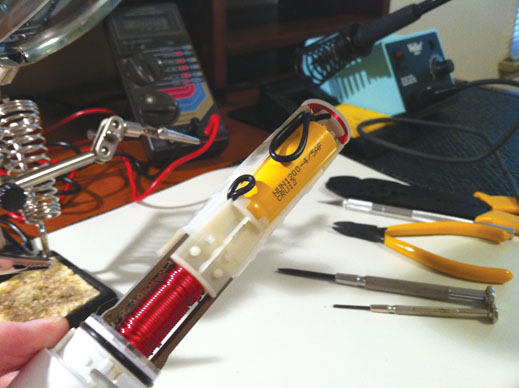 To prolong her toothbrush's life, Quinn replaced a toothbrush battery with a nickel–cadmium battery and added wires to the old battery's PCB mount points.