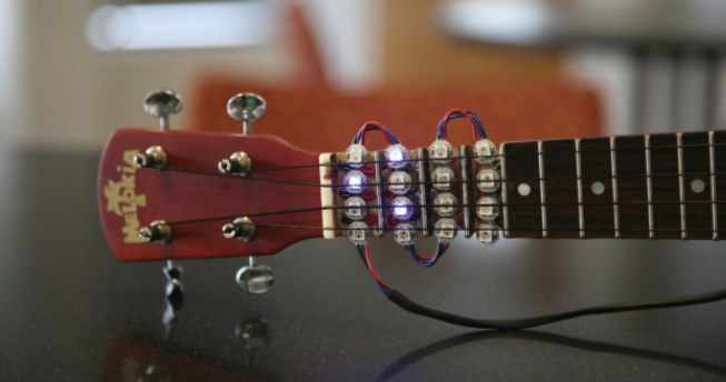 Photo 3 Gm is a minor chord and is lit up in red (a). G7 is a seventh chord and is lit up in blue (b).