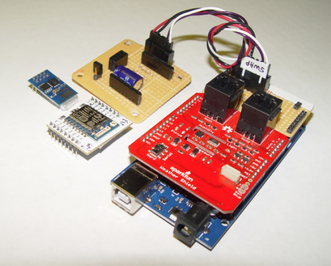 """Photo 3 My Arduino Mega 2560 has a short """"Weather"""" shield and a small prototyping board plugged into its expansion bus. The prototyping board picks up a hardware serial port and power and ground for interfacing to a serial device using a universal six-pin header. (For this project I use an ESP8266 Wi-Fi module.)"""