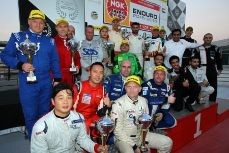 All the NGK 3 Hours trophy winners on the Dubai Autodrome podium