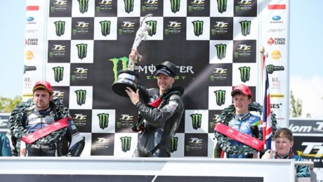 Supersport TT Race 2: 'Hutchy' hoists the Junior TT trophy into the air on the podium for the Monster Energy Supersport TT Race 2