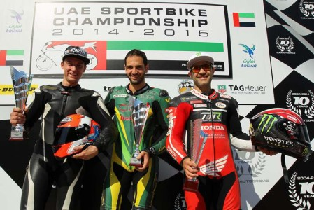 UAE Sportbikes top three podium (L to R) second placed Vladmir Ivanov, winner Abdulaziz Binladen and third placed Mahmoud Tannir