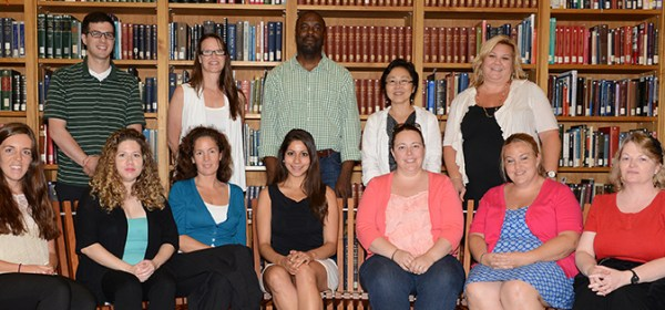 NLM staff and Teacher institute participants pose for a group photo in the library reading room