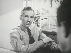 A distinguished looking man sits smoking in conversation.
