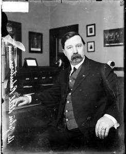 Seated portrait of John Robertson in an office.