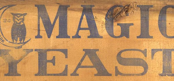 Wooden board reading Magic Yeast