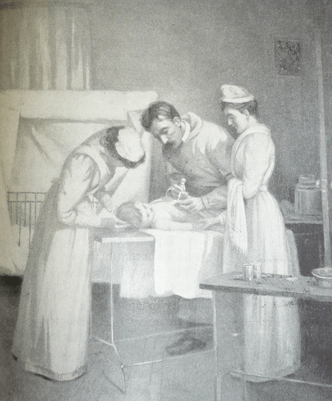 A doctor give a small child an injection assisted by two nurses.